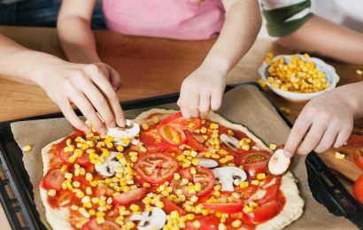 Every pizza slice you eat shortens your lifespan by nearly 8 minutes – but french fries INCREASE your time