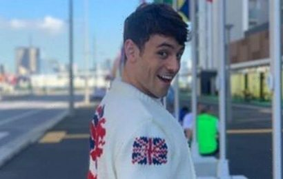 Olympic star Tom Daley models his knitted Team GB cardigan – and explains why he made it
