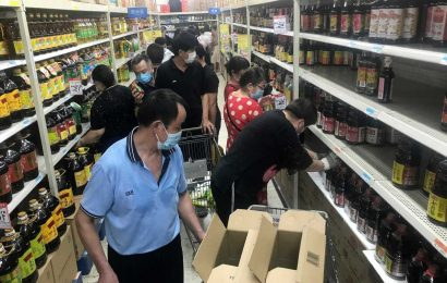 Panic-buyers raid Wuhan shop shelves as Covid cases hit pandemic 'ground zero' for first time since outbreak