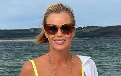 Amanda Holden, 50, shows off her incredible figure in a yellow bikini as she goes for a dip in the sea