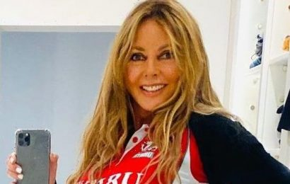 Carol Vorderman, 60, shows off her famous bum in sexy skintight leather trousers