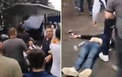 West Brom v Millwall – Fan 'knocked unconscious' as yobs throw bottles and 'smash Hawthorns gate' in sickening scenes