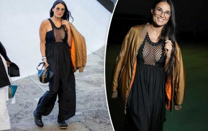 Demi Moore sports plunging jumpsuit at Paris Fashion Week