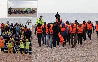 Dozens of migrants land on beach in Kent escorted by the RNLI